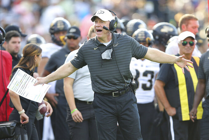 Purdue head coach Jeff Brohm argues a call during the second half of an NCAA football game against Connecticut on Saturday, Sept. 11, 2021, in East Hartford, Conn. (AP Photo/Stew Milne)