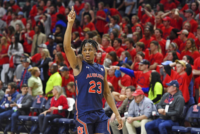 Auburn forward Isaac Okoro reacts after the team's 83-82 win over Mississippi in two overtimes in an NCAA college basketball game in Oxford, Miss., Tuesday, Jan. 28, 2020. (AP Photo/Thomas Graning)