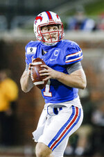 SMU quarterback Shane Buechele (7) looks for an open receiver during the first half of an NCAA college football game against Navy, Saturday, Oct. 31, 2020, in Dallas. (AP Photo/Brandon Wade)
