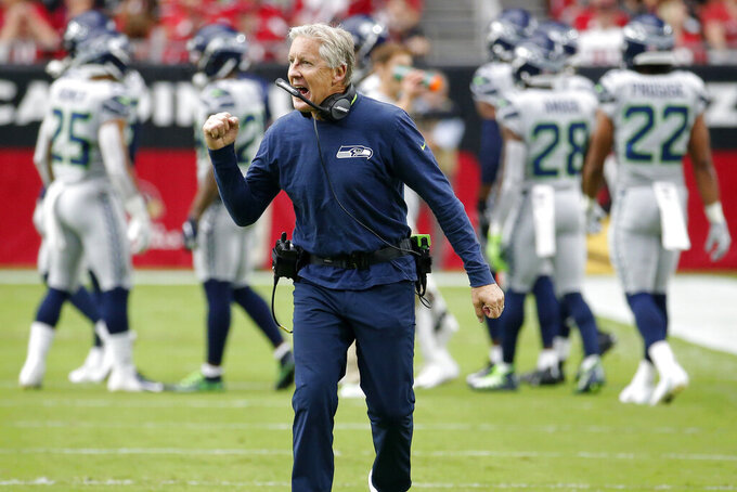 Seattle Seahawks head coach Pete Carroll cheers on his team during the first half of an NFL football game against the Arizona Cardinals, Sunday, Sept. 29, 2019, in Glendale, Ariz. (AP Photo/Rick Scuteri)