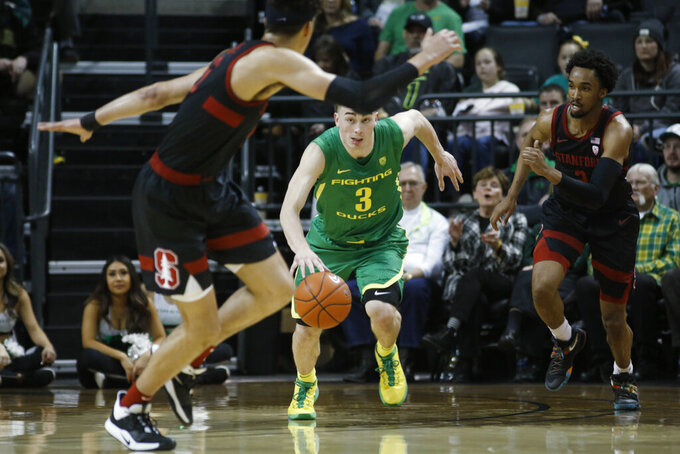 Oregon guard Payton Pritchard (3) brings the ball up during the first half of the team's NCAA college basketball game against Stanford in Eugene, Ore., Saturday, March 7, 2020. (AP Photo/Thomas Boyd)