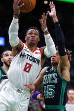 Houston Rockets' Russell Westbrook (0) shoots next to Boston Celtics' Romeo Langford (45) during the first half of an NBA basketball game in Boston, Saturday, Feb. 29, 2020. (AP Photo/Michael Dwyer)