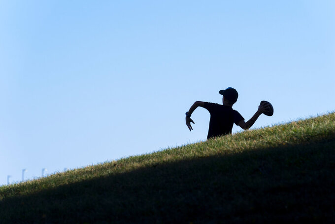 A young fan throws a football outside Memorial Stadium before the start of a Missouri NCAA college football game against Southeast Missouri State Saturday, Sept. 18, 2021, in Columbia, Mo. (AP Photo/L.G. Patterson)