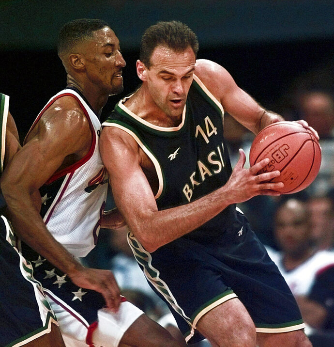 FILE - In this Tuesday, July 30, 1996 file photo, Brazil's Oscar Schmidt (14) drives past Scottie Pipen (8) of the United States during the quarterfinals of basketball competition at the Centennial Summer Olympic Games in Atlanta. For little Kobe Bryant growing up in Italy the player that amazed him as a child was skinny and half-bald Brazilian guard Oscar Schmidt.  (AP Photo/Hans Deryk, File)