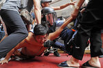 In this Saturday, Sept. 14, 2019, file photo, police detain a man after fights broke out between pro-China supporters and anti-government protesters outside the Amoy Plaza in the Kowloon Bay district in Hong Kong. Skirmishes broke out Saturday at a shopping mall in Hong Kong between supporters of the ongoing protests for democratic reforms in the semiautonomous Chinese territory and people backing the central government in Beijing. (AP Photo/Kin Cheung, File)