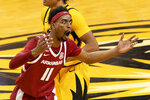 Arkansas' Jalen Tate pleads with the referee after being called for a foul during the second half of an NCAA college basketball game against Missouri, Saturday, Feb. 13, 2021, in Columbia, Mo. (AP Photo/L.G. Patterson)