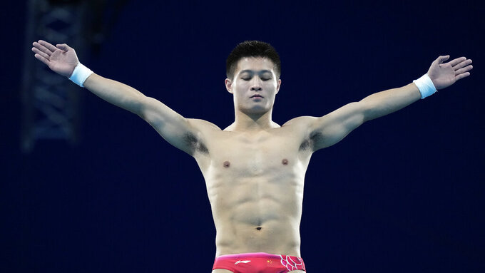 Yang Jian of China competes in men's diving 10m platform final at the Tokyo Aquatics Centre at the 2020 Summer Olympics, Saturday, Aug. 7, 2021, in Tokyo, Japan. (AP Photo/Dmitri Lovetsky)