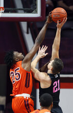 Virginia Tech's Justyn Mutts (25) blocks a shot by Penn State's John Harrar (21) during the first half of an NCAA college basketball game, Tuesday, Dec. 8, 2020 in Blacksburg Va. (Matt Gentry/The Roanoke Times via AP, Pool)