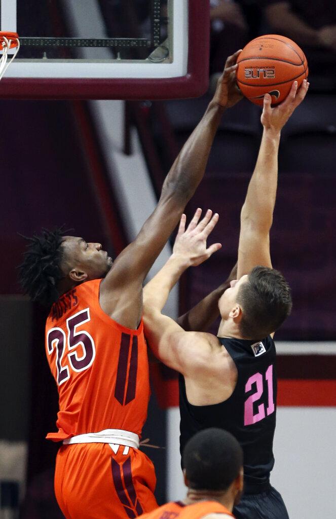 Virginia Tech's Justyn Mutts (25) blocks a shot by Penn State's John Harrar (21) during the first half of an NCAA college basketball game, Tuesday, Dec. 8, 2020 in Blacksburg Va. (Matt Gentry/The Roanoke Times via AP, Pool)