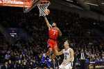 DePaul's Devin Gage (3) goes up for a shot against Villanova's Collin Gillespie (2) during the first half of an NCAA college basketball game, Wednesday, Jan. 2, 2019, in Villanova, Pa. (AP Photo/Matt Slocum)