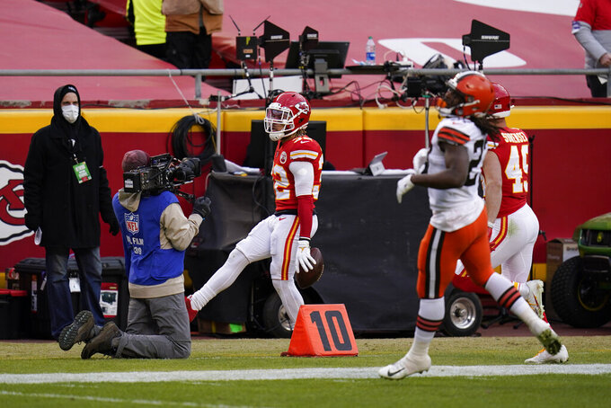 Kansas City Chiefs safety Tyrann Mathieu (32) celebrates after intercepting a pass during the second half of an NFL divisional round football game against the Cleveland Browns, Sunday, Jan. 17, 2021, in Kansas City. (AP Photo/Jeff Roberson)
