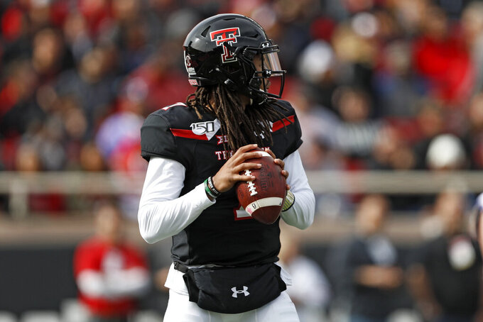 Texas Tech's Jett Duffey (7) looks to pass the ball during the first half of an NCAA college football game against TCU, Saturday, Nov. 16, 2019, in Lubbock, Texas. (Brad Tollefson/Lubbock Avalanche-Journal via AP)