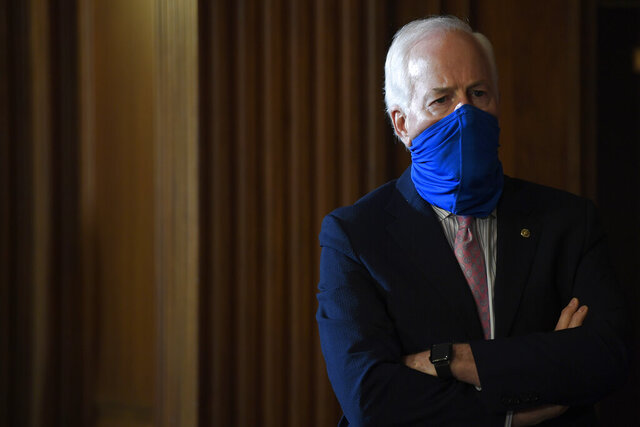 Sen. John Cornyn, R-Texas, listens during a news conference on Capitol Hill in Washington, Monday, July 27, 2020, to highlight the new Republican coronavirus aid package. (AP Photo/Susan Walsh)