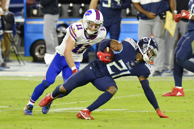 Tennessee Titans cornerback Malcolm Butler (21) intercepts a pass as Buffalo Bills wide receiver Cole Beasley (11) tries to bring him down in the second half of an NFL football game Tuesday, Oct. 13, 2020, in Nashville, Tenn. (AP Photo/Mark Zaleski)