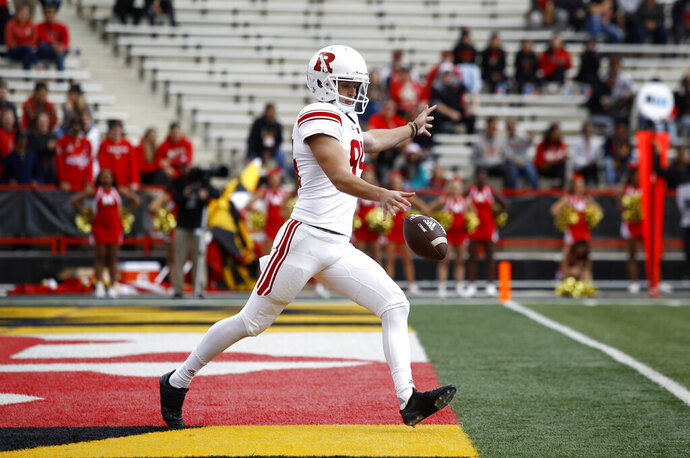 FILE - In this Oct. 13, 2018, fikle photo, Rutgers punter Adam Korsak punts the ball in the first half of an NCAA college football game against Maryland, in College Park, Md. The Big Ten Conference knows the value of having good punters, and they are sometimes willing to go a long way to get them. Korsak is a former Australian rules football player who trained at ProKick Australia before coming to the United States. (AP Photo/Patrick Semansky, File)