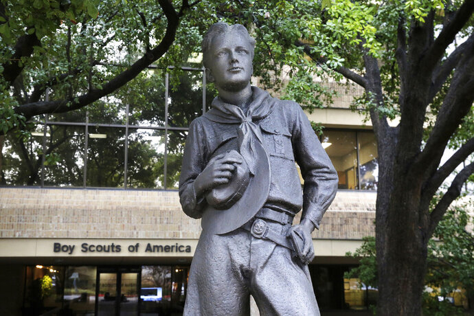 In this Wednesday, Feb. 12, 2020, photo, a statue stands outside the Boys Scouts of America headquarters in Irving, Texas. The Boy Scouts of America has filed for bankruptcy protection as it faces a barrage of new sex-abuse lawsuits. The filing Tuesday, Feb. 18, in Wilmington, Delaware, is an attempt to work out a potentially mammoth compensation plan for abuse victims that will allow the 110-year-old organization to carry on. (AP Photo/LM Otero)