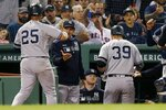 New York Yankees' Mike Tauchman (39) celebrates his two-run home run, that also drove in Gleyber Torres (25), during the fourth inning of a baseball game against the Boston Red Sox in Boston, Sunday, Sept. 8, 2019. (AP Photo/Michael Dwyer)