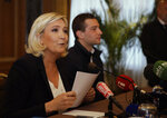 Leader of the French National Front Marine Le Pen, left, and Far-right top candidate of the National Rally party Jordan Bardella attend a press conference before a rally with right-wing EU leaders in Milan, Italy, Saturday, May 18, 2019. (AP Photo/Luca Bruno)