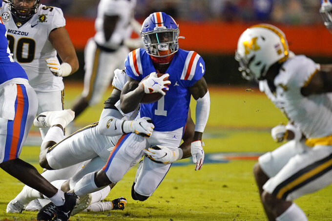 Florida wide receiver Kadarius Toney (1) runs after a reception before he being stopped by the Missouri defense during the first half of an NCAA college football game, Saturday, Oct. 31, 2020, in Gainesville, Fla. (AP Photo/John Raoux)