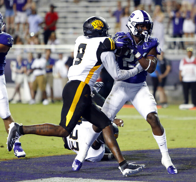 TCU's Darwin Barlow (24) scores late in the game, defended by Arkansas-Pine Bluff's Rico Merriweather (9), during an NCAA college football game Saturday, Aug. 31, 2019, in Fort Worth, Texas. (David Kent/Star-Telegram via AP)