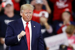 President Donald Trump gestures as he arrives at a campaign rally in Hershey, Pa., Tuesday, Dec. 10, 2019. (AP Photo/Matt Rourke)