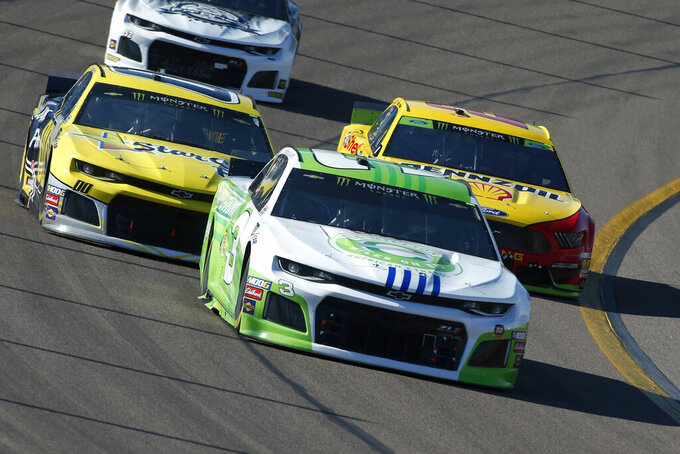 Austin Dillon (3), Landon Cassill (00) and Joey Logano (22) during the NASCAR Cup Series auto race at ISM Raceway, Sunday, Nov. 10, 2019, in Avondale, Ariz. (AP Photo/Ralph Freso)