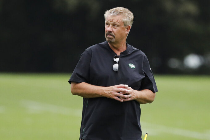 FILE - In this Aug. 21, 2019, file photo, New York Jets defensive coordinator Gregg Williams watches as players take part in drills at the team's NFL football training facility in Florham Park, N.J. Williams is fired up about the guys on his defense whose job is to make quarterbacks downright uncomfortable. (AP Photo/Frank Franklin II, File)