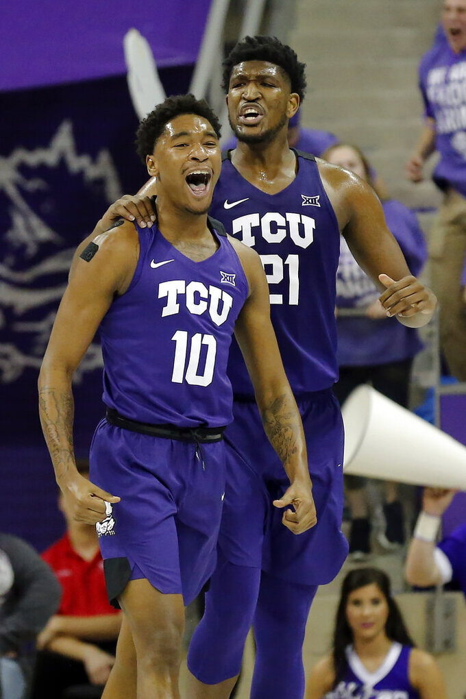 TCU forward Diante Smith (10) and center Kevin Samuel (21) react to a turnover by Texas Tech during the second half of an NCAA college basketball game in Fort Worth, Texas, Tuesday, Jan. 21, 2020. TCU won 65-54. (AP Photo/Ray Carlin)
