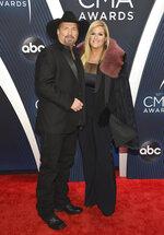 Garth Brooks, left, and Trisha Yearwood arrive at the 52nd annual CMA Awards at Bridgestone Arena on Wednesday, Nov. 14, 2018, in Nashville, Tenn. (Photo by Evan Agostini/Invision/AP)