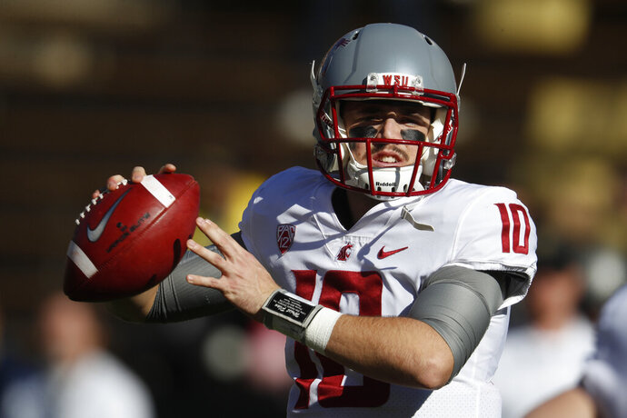 FILE - In this Saturday, Nov. 10, 2018, file photo, Washington State quarterback Trey Tinsley warms up before the first half of an NCAA college football game in Boulder, Colo. Washington State has a spirited quarterback competition involving a large group of would-be starters, including seniors Anthony Gordon and Tinsley, Cammon Cooper, graduate transfer Gage Gubrud and sophomore John Bledsoe. (AP Photo/David Zalubowski, File)