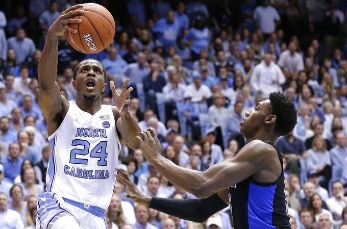 North Carolina's Kenny Williams (24) drives to the basket as Duke's RJ Barrett defends during the first half of an NCAA college basketball game in Chapel Hill, N.C., Saturday, March 9, 2019. (AP Photo/Gerry Broome)