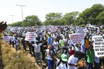 Some hundreds of people marching on the streets of Harare, Friday, Oct, 25, 2019, in protest over US sanctions that the Zimbabwean government blames for the country's worsening economic problems. The Zimbabwe government blames U.S. sanctions for devastating economic conditions, galloping inflation and severe shortages of basic goods, but the U.S denies the allegation and blames corruption, financial mismanagement and human rights violations instead.(AP Photo/Tsvangirayi Mukwazhi)