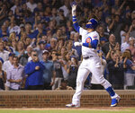 Chicago Cubs Javier Baez (9) celebrates his home run during the seventh inning against the Philadelphia Phillies in a baseball game Wednesday, May 22, 2019, in Chicago. (AP Photo/Mark Black)