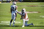 Auburn quarterback Bo Nix (10) and Eli Stove (12) react after an NCAA college football game against South Carolina Saturday, Oct. 17, 2020, in Columbia, S.C. South Carolina defeated Auburn 30-22. (AP Photo/Sean Rayford)