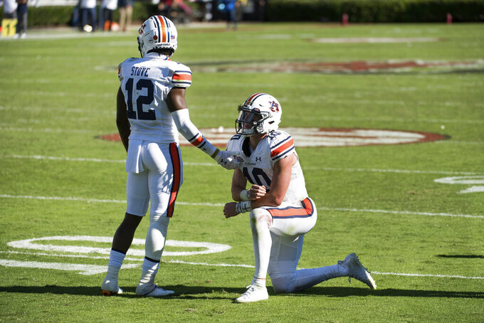 Auburn quarterback Bo Nix (10) and Eli Stove (12) react after an NCAA college football game against South Carolina Saturday, Oct. 17, 2020, in Columbia, S.C. South Carolina defeated Auburn 30-22. (AP Photo/Sean Rayford)