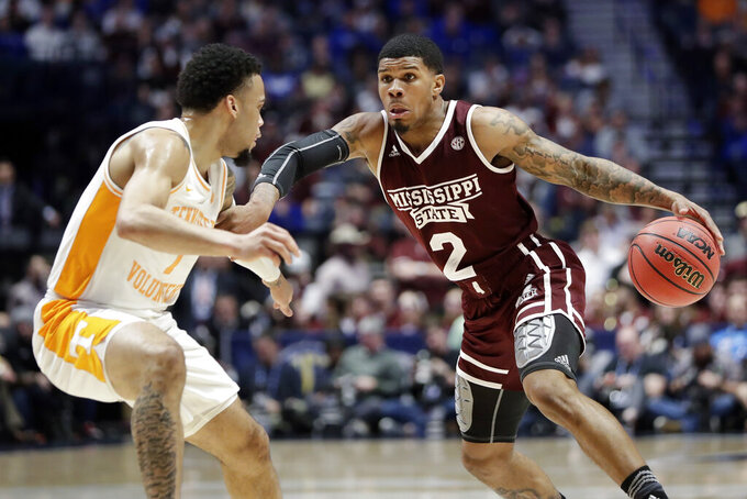 Mississippi State guard Lamar Peters (2) drives against Tennessee's Lamonte Turner (1) in the first half of an NCAA college basketball game at the Southeastern Conference tournament Friday, March 15, 2019, in Nashville, Tenn. (AP Photo/Mark Humphrey)