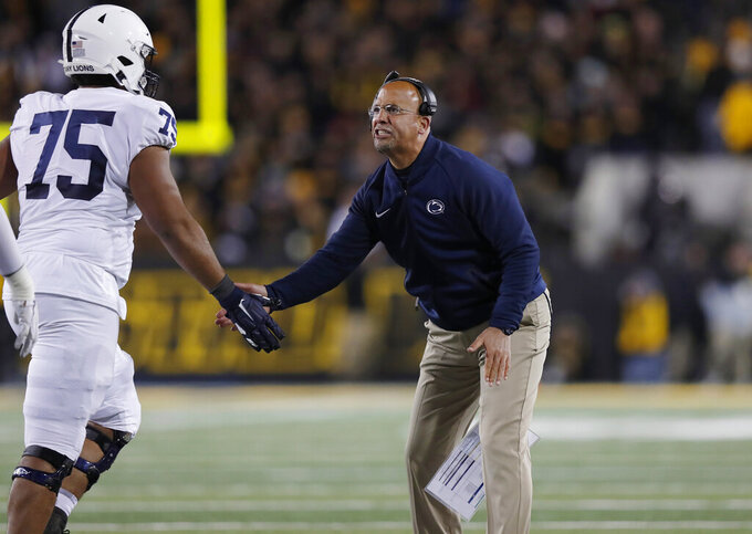 Penn State coach James Franklin, right, congratulates offensive lineman Des Holmes after a successful extra point during the second half of the team's NCAA college football game against Iowa, Saturday, Oct. 12, 2019, in Iowa City, Iowa. Penn State won 17-12. (AP Photo/Matthew Putney)
