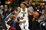 Colorado guard D'Shawn Schwartz, right, looks to pass the ball as Washington State guard Noah Williams defends in the first half of an NCAA college basketball game Thursday, Jan. 23, 2020, in Boulder, Colo. (AP Photo/David Zalubowski)