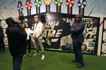 Chicago White Sox's Luis Robert, left, is interviewed as Jose Abreu stands off to the side during the team's annual fan convention Friday, Jan. 24, 2020, in Chicago. (AP Photo/Charles Rex Arbogast)