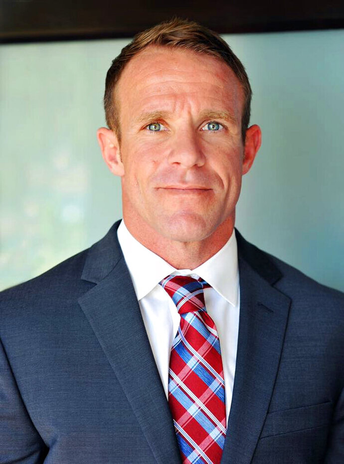 FILE - This 2018 file photo provided by Andrea Gallagher shows her husband, Navy SEAL Edward Gallagher. A military judge on Tuesday, Feb. 12, 2019, asked the Navy to address claims that allegations from a potential government witness were being leaked to the media in the case of Gallagher, a SEAL charged with murder in the 2017 death of an Iraqi war prisoner. (Andrea Gallagher via AP, File)