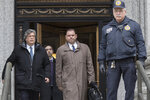 Joseph Percoco, center, former top aide to New York Gov. Andrew Cuomo, leaves U.S. District court, Tuesday, March 13, 2018, in New York. Percoco was convicted on corruption charges Tuesday at a trial that further exposed the state capital's culture of backroom deal-making. (AP Photo/Mary Altaffer)