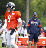 FILE - In this Aug. 25, 2020, file photo, Chicago Bears quarterbacks coach Dave Ragone watches quarterback Nick Foles (9) during NFL football training camp at Halas Hall in Lake Forest, Ill. Arthur Smith, the new Atlanta Falcons coach, has started building his staff by hiring offensive coordinator Dave Ragone, defensive coordinator Dean Pees and special teams coach Marquice Williams.  (Brian Cassella/Chicago Tribune via AP, Pool, File)