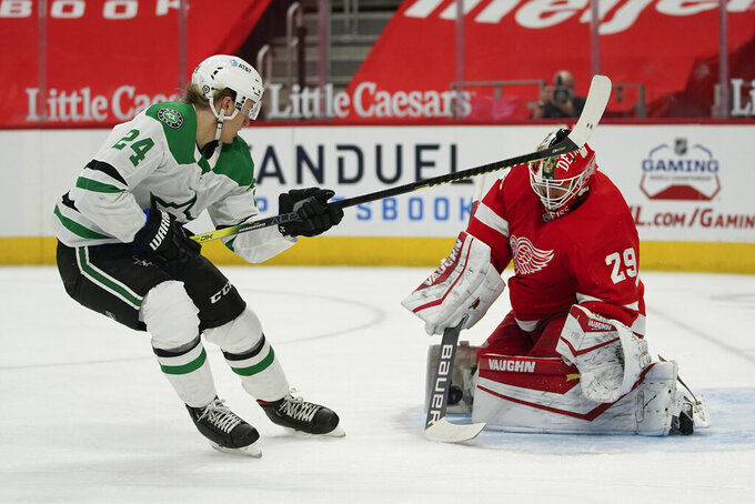 Detroit Red Wings goaltender Thomas Greiss (29) stops a Dallas Stars' Esa Lindell (23) shot in the first period of an NHL hockey game Thursday, April 22, 2021, in Detroit. (AP Photo/Paul Sancya)