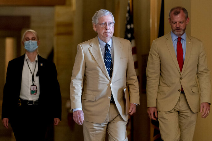 Senate Minority Leader Mitch McConnell of Ky. walks towards the Senate chamber as the $1 trillion bipartisan infrastructure bill gets closer to passage in Washington, Monday, Aug. 9, 2021. (AP Photo/Andrew Harnik)