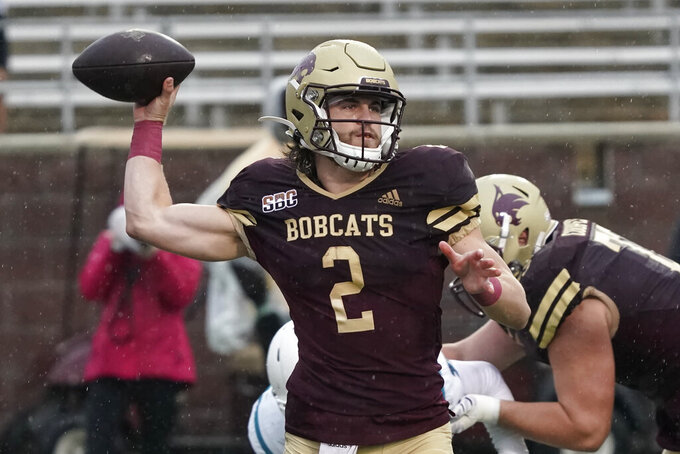 Texas State quarterback Brady McBride (2) looks to pass against Coastal Carolina during the first half of an NCAA college football game in San Marcos, Texas, Saturday, Nov. 28, 2020. (AP Photo/Chuck Burton)