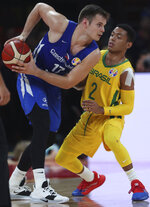 Czech Republic's Jaromir Bohacik tries to get past Brazil's Yago Mateus during phase two of the FIBA Basketball World Cup at the Shenzhen Bay Sports Center in Shenzhen in southern China's Guangdong province on Saturday, Sept. 7, 2019. (AP Photo/Ng Han Guan)