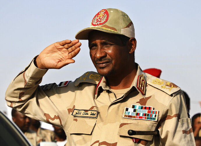 Gen. Mohammed Hamdan Dagalo, the deputy head of the military council that assumed power in Sudan after the overthrow of President Omar al-Bashir, salutes during a rally, in Galawee town, north of Sudan, Saturday, June 15, 2019. The top U.S. diplomat to Africa said there must be an