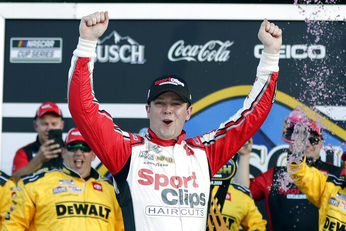 Erik Jones celebrates in Victory Lane after winning the NASCAR Busch Clash auto race at Daytona International Speedway, Sunday, Feb. 9, 2020, in Daytona Beach, Fla. (AP Photo/John Raoux)