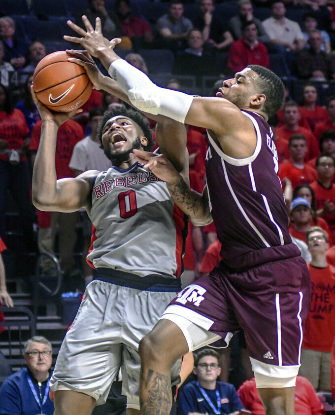 Mississippi guard Blake Hinson (0) is fouled by Texas A&M's Savion Flagg (1) during an NCAA college basketball game, Wednesday, Feb. 6, 2019 in Oxford, Miss. (Bruce Newman/The Oxford Eagle via AP)