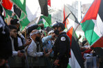 Protesters gather and protest in support of Palestinians in front Consulate General of Israel, Wednesday, May 12, 2021, in Chicago. (AP Photo/Shafkat Anowar)